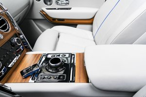 example of a detailed center console with white leather and wood inlays in Arlington TX